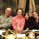 Loughton Smith posing for an after-dinner photo with two of his students and their Japanese guide