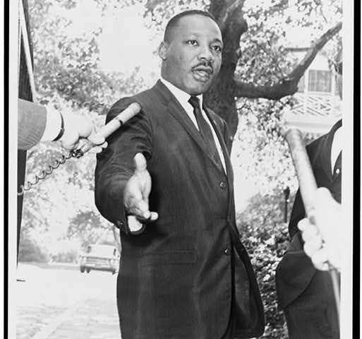 Photo of MLK Jr. talking to the press