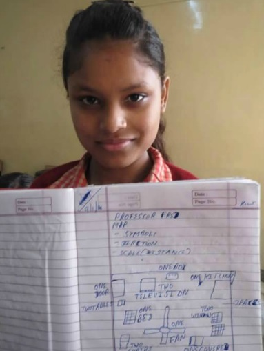 An Indian girl showing her notes written in her notebook
