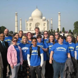 Kirkwood students, faculty, & partners standing in front of the Taj Mahal in India